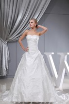 Long Sleeveless A-Line Lace Gown With Tulle Overlay and Cinched Waistband