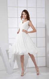 Sleeveless Knee-Length Low-V-Back Pleats and Dress With Ruching