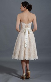 Knee Length A-Line Lace Gown With Lace-Up Back and Back Bow