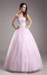 Blushing Strapless Beaded Ball Gown With Tulle Overlay