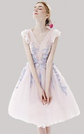 Floral Appliqued Ethereal Tulle Knee Length Dress With Criss Cross And Cap Sleeves