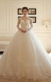 Elegant Lace and Tulle Scalloped Long Sleeved Ball Gown Wedding Dress