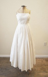A-Line Lace Bridal Gown With Spaghetti Straps and Pleated Skirt
