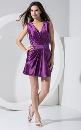 Plunged Short Sleeveless Ruching and Dress With Broach