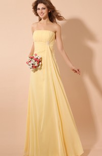 Strapless Chiffon Empire Dress With Pleating and Broach