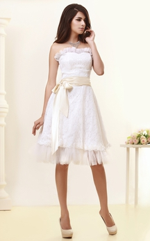 Strapless Knee-Length Dress With Bow and Appliques