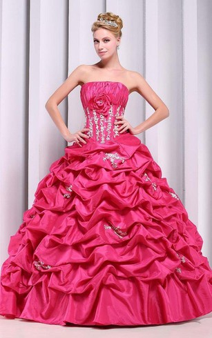 Strapless Ball Gown With Ruffles and Flower Detail